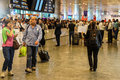 Arriving passengers run the gauntlet of travel guides istanbul turkey may as they exit customs area airport in istanbul Stock Photography