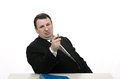 Arrogant interviewer pointing jobseeker with pen middle aged in stress interview Stock Images