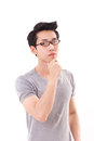 Arrogant thinking nerd man looking at you, white isolated background Royalty Free Stock Photo