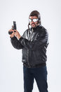 Arrogant young man holding a gun pointed upwards is his finger on the trigger of isolated on white Royalty Free Stock Photography