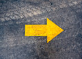 Arrow on the asphalt road Royalty Free Stock Photo