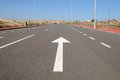 Arrow on a asphalt street to the future in tenerife spain Stock Images
