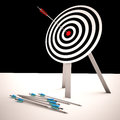 Arrow on dartboard shows centered shot or accurate aim Royalty Free Stock Image