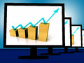 Arrow going up on monitors shows financial growth and success Royalty Free Stock Photos