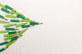 Arrow made with many green pens - business concept Royalty Free Stock Photo