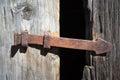 Arrow-shaped rusty latch Royalty Free Stock Photo