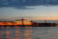 Arrow of vasilevsky island rostral columns and naval museum ill illuminated at sunset the reflection in the water the river neva Stock Photography