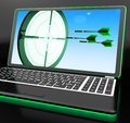 Arrows aiming on laptop showing extreme accuracy or perfect targeting Royalty Free Stock Photos