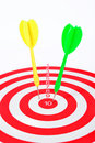 Arrows dart hitting the center of a target success business concept Stock Photography