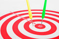 Arrows dart hitting the center of a target success business concept Royalty Free Stock Images
