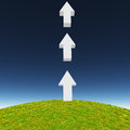 Arrows point upward atop hill Royalty Free Stock Photo