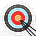 Arrows pointing to the center of archery target Stock Photos