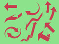 Arrows set red isolated on green Stock Images
