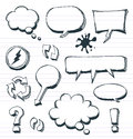 Arrows speech bubbles and doodle elements set illustration of a group of outlined hand drawn sketched signs on school paper with Royalty Free Stock Image