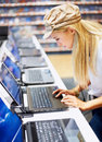 Arrtractive woman in store looking at laptop Stock Image