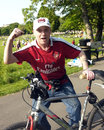 Arsenal supporter with his bike fan makes a winning gesture in a local park Royalty Free Stock Image