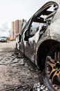 Arson fire burnt wheel car vehicle junk road wreck accident or Royalty Free Stock Photos