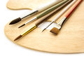 Art brushes with wooden palette isolated color on on white background Royalty Free Stock Image