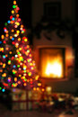 Art christmas scene background with tree gifts and fire in Royalty Free Stock Photos
