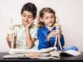 Art class boy and girl children using wooden dummies at painting tools on the table Royalty Free Stock Image