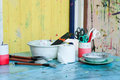 Art class paintbrushes and other supplies on a desk in Royalty Free Stock Photo