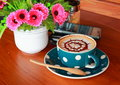 Art coffee cup and flower on table Royalty Free Stock Photography