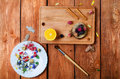 Art conceptual photo with flowers, brush, fruit spices  on a pla Royalty Free Stock Photo
