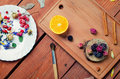 Art conceptual photo with flowers, brush, fruit and spices  on a Royalty Free Stock Photo