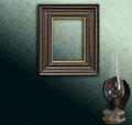 Art deco empty frame on green damask and oil lamp Royalty Free Stock Photos