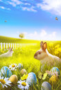 Art Easter bunny and easter eggs on field Royalty Free Stock Photo