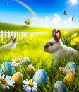 Art Easter bunny rabbit and easter eggs on meadow. Royalty Free Stock Photo