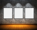 Art gallery blank picture frames on brick wall background Stock Photos