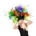 Art girl with paint coming out of black hat a is wearing a top that has rainbow splatters the top on a white isolated background Royalty Free Stock Images