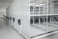 Art history museum depository warehouse archive with empty grey shelves and storage space Royalty Free Stock Photography