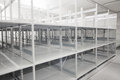 Art history museum depository warehouse archive with empty grey shelves and storage space Royalty Free Stock Image