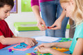 Art lesson children enjoy with creative teacher at kindergarten Royalty Free Stock Image