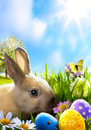 Art Little Easter bunny and Easter eggs on green grass Royalty Free Stock Photo