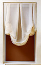 Art nouveau style curtain in window frame Royalty Free Stock Photo