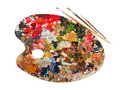 Art palette with blobs of paint and a brush Royalty Free Stock Photography