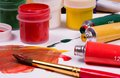 Art supplies acrylic paint on pallette and tubes Stock Photo