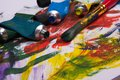 Art supplies acrylic paint on pallette and tubes Royalty Free Stock Photo