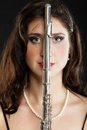 Art woman flutist flautist with flute music and artist portrait of girl performer musical instrument on black classical Stock Photo