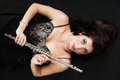 Art woman flutist flautist with flute music and artist portrait of girl performer musical instrument on black classical Royalty Free Stock Photo