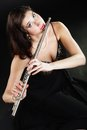 Art woman flutist flautist playing flute music and artist portrait of girl performer musical instrument on black classical Stock Photo