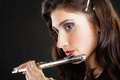 Art woman flutist flautist playing flute music and artist portrait of girl performer musical instrument on black classical Royalty Free Stock Photo