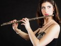 Art woman flutist flautist playing flute music and artist portrait of girl performer musical instrument on black classical Stock Photos