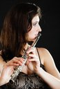 Art woman flutist flautist playing flute music and artist young elegant girl performer musical instrument on black classical Stock Images