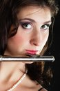 Art woman flutist flautist playing flute music and artist young elegant girl performer musical instrument on black classical Stock Image