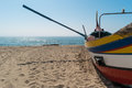 Arte Xavega typical portuguese old fishing boat on the beach in Royalty Free Stock Photo