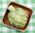 Artichoke on a Picnic Blanket. Royalty Free Stock Images